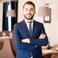Confident handsome businessman in restaurant