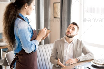 Man sharing his taste preference with waitress