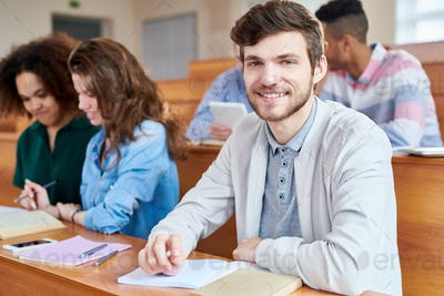Happy handsome guy in lecture room