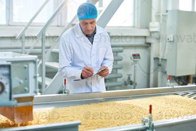 Senior Worker Overseeing Production of Food