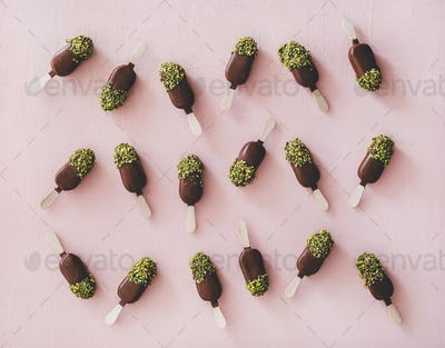 Chocolate glazed ice-cream pops with pistachio icing, top view
