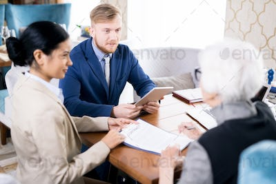 Insurance agents with senior woman