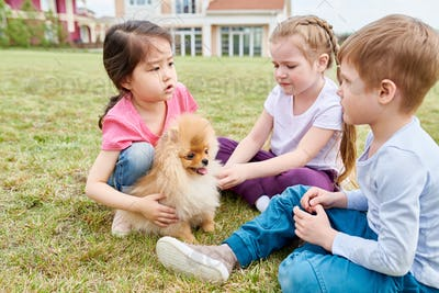 Kids Playing with Puppy