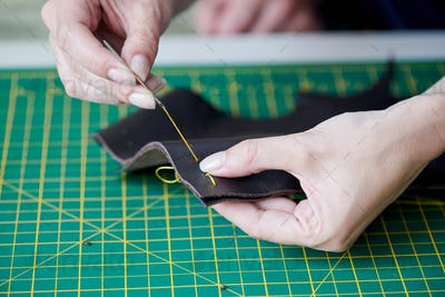 Sewing goods from leather