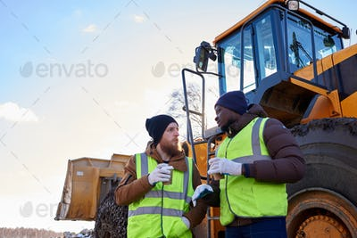 Two Workers Talking Outdoors