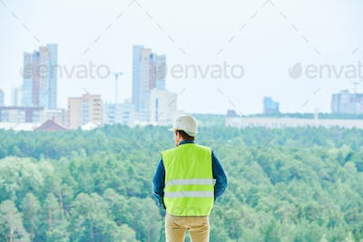 Construction engineer choosing place for building