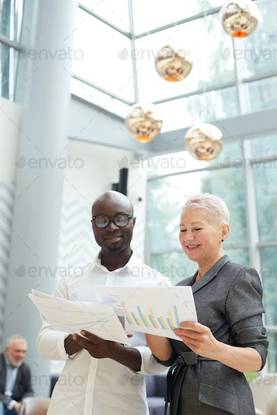Business People Reading Report