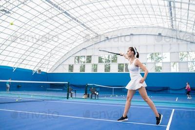 Young Woman Playing Tennis Action Shot