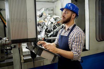 Bearded Worker using Power Units