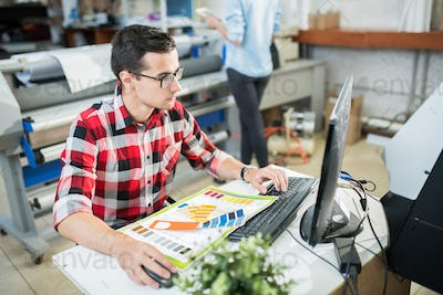 Designer working on computer in office