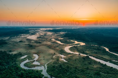 Aerial View Green Meadow And River Landscape In Misty Foggy Morn