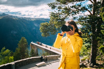 Norway. Young Adult Caucasian Woman Lady Tourist Traveler Photog