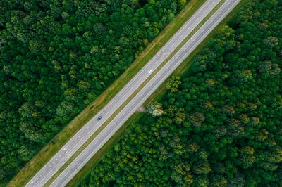 Aerial View Of Highway Road Through Green Forest Landscape In Su