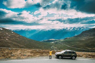 Aurlandsfjellet, Norway. Young Caucasian Woman Lady Tourist Trav