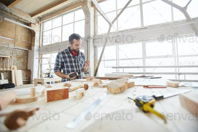 Mature Carpenter Working with Wood Background