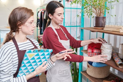 Two Women Counting Goods in Store