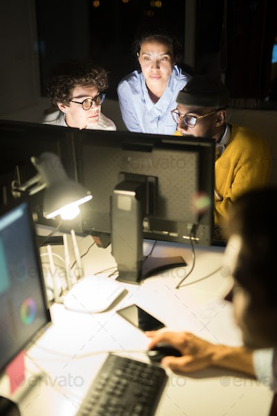 Group of Colleagues Working at Night