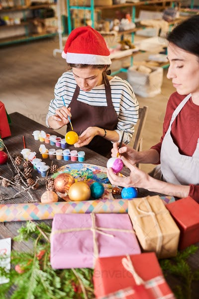 Women Painting Christmas Decorations
