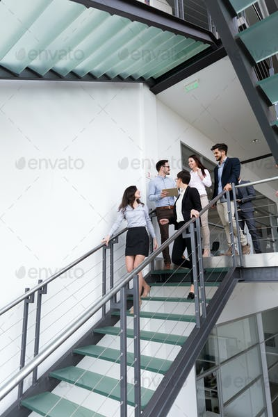 Business people having conversation at office building
