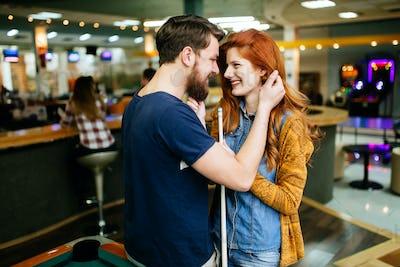 Couple hugging in snooker bar