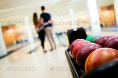 Couple enjoy bowling together