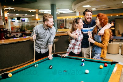 Group of people playing snooker
