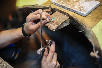 Young goldsmith crafting jewelry