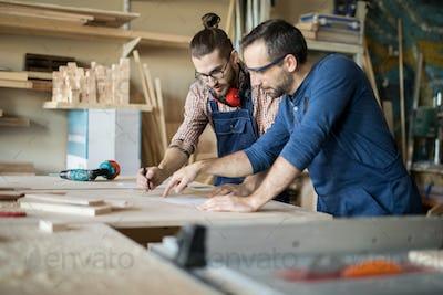 Carpenters Discussing Plans