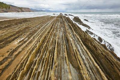 Flysch dramatic rock formation Cantabric sea in Zumaia, Euskadi. Spain
