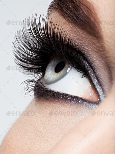 woman's eye with black eye makeup. Macro style image