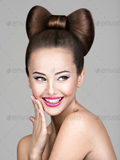 Smiling  face of  young woman  with creative hairstyle