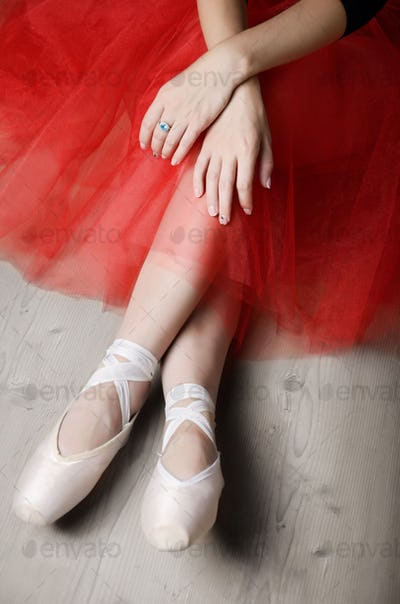 Ballerina's crossed hands and feet while rest time