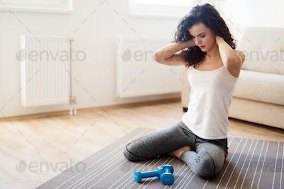 Injured beautiful sporty woman having neck ache