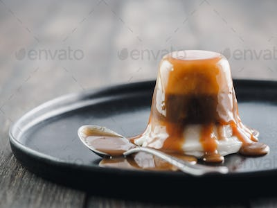 Panna cotta with caramel sauce , copy space