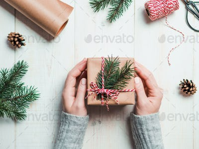 Woman packing presents for Christmas in boxes