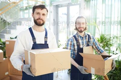 Positive movers carrying boxes