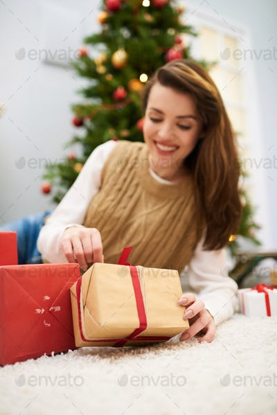 Pretty Woman Unwrapping Christmas Present