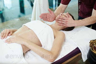 Male Masseur Massaging young Woman in SPA