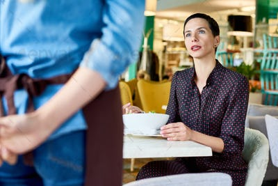 Woman Complaining in Cafe