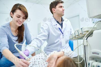 Doctors examining small patient