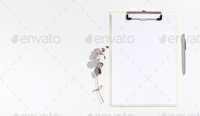 Office clipboard with white sheet of paper for advertisement