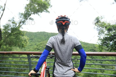 Cyclist enjoy the view while cycling on rainforest