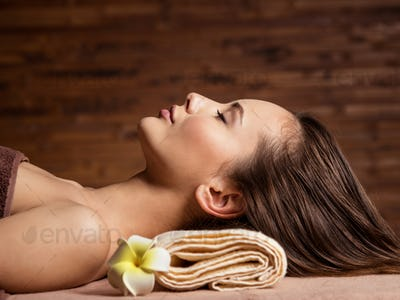young  woman relaxing in spa salon. Beauty treatment. Spa salon