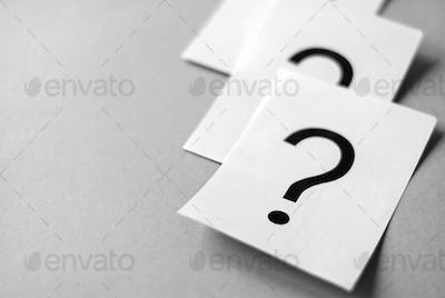 White cards with printed question marks