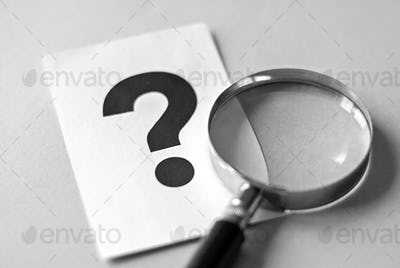 Magnifying glass and question mark search concept