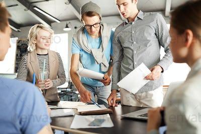 Designers discussing data