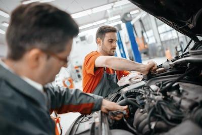 Car mechanic working at service center