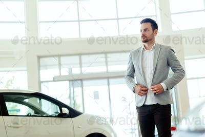 Salesperson at car dealership