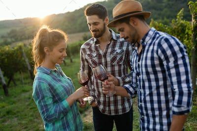 Wine grower family in vineyard before harvesting