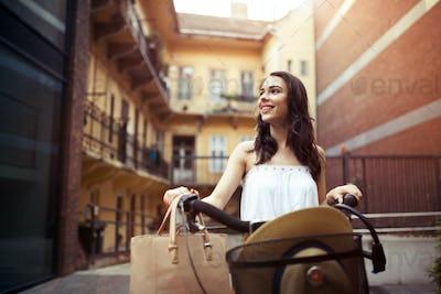 Tourist woman using bicycle